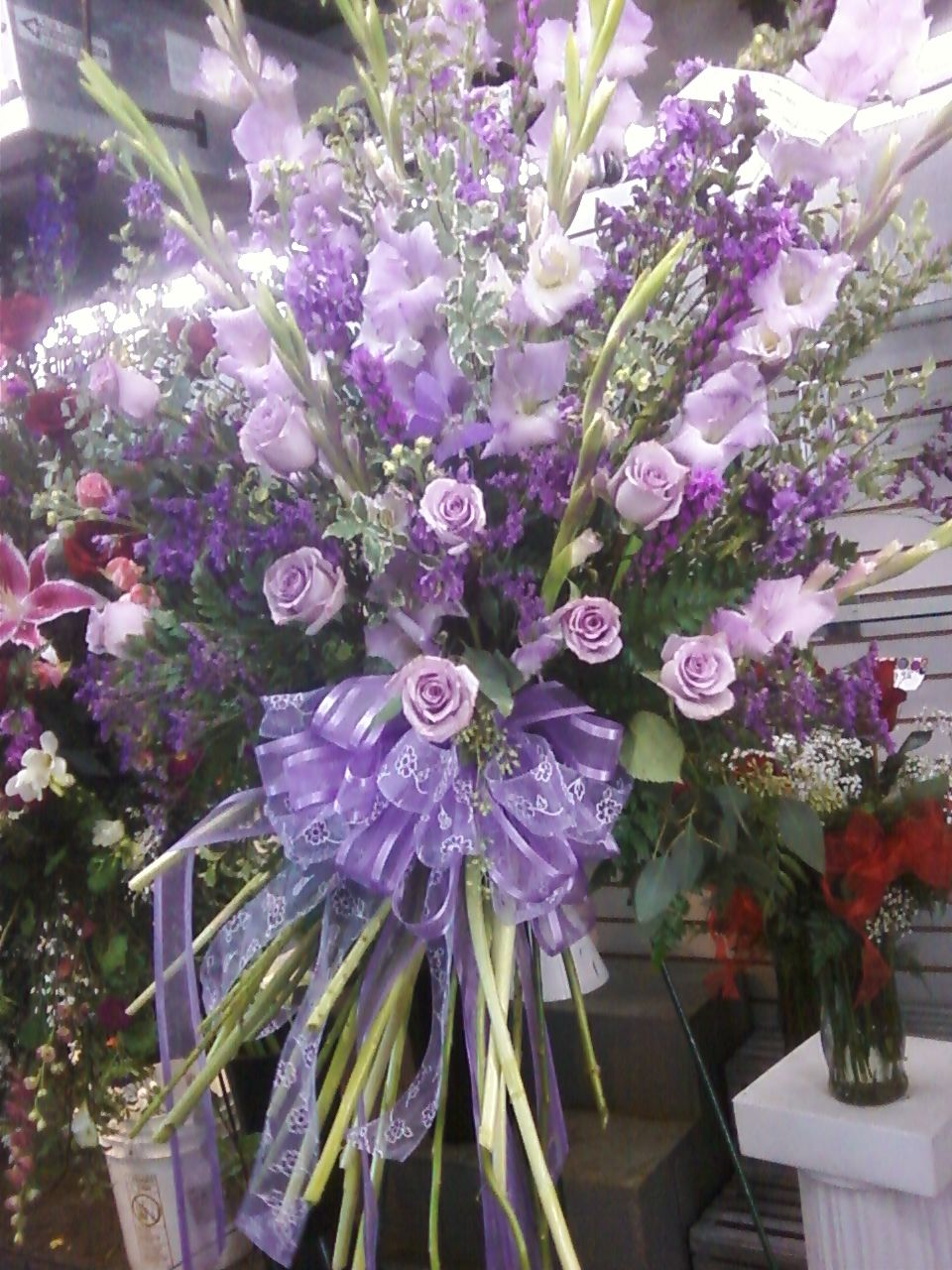 Shades Of Lavender And Purple Flowers In A Funeral Spray Funeral