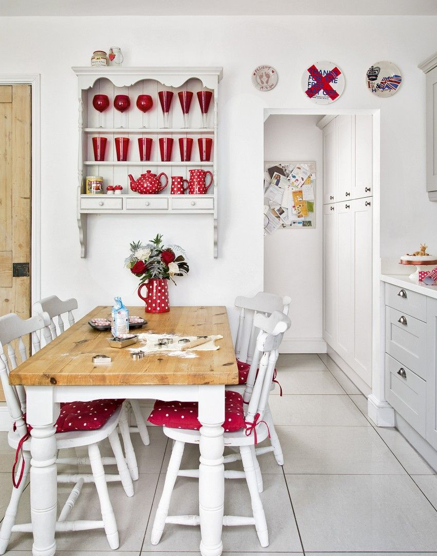 White Country Kitchen With Red Accessories Make A Short Hallway Coming In From Back Door