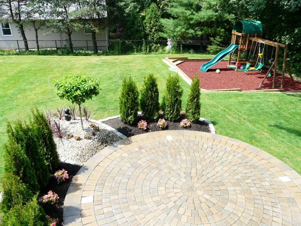 Landscaping around patios landscape 781 858 8000 for Back garden patio ideas