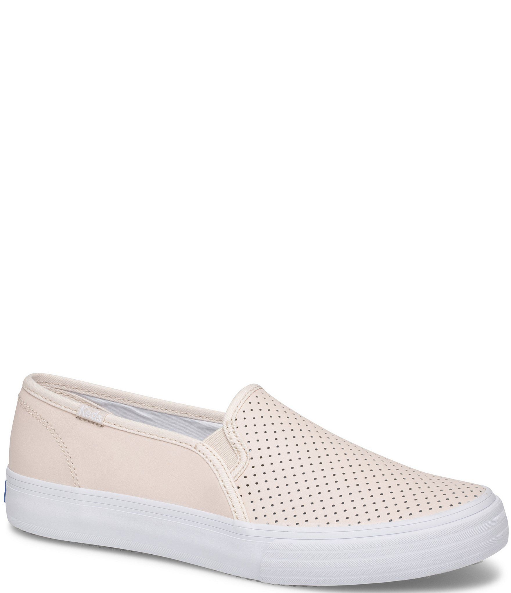 From Keds, the Double Decker Perforated Leather Slip On Sneakers feature:Leather upperPerforated detailsSlip on with goringFabric liningDream Foam™ footbedRubber outsoleFlat heelImported.