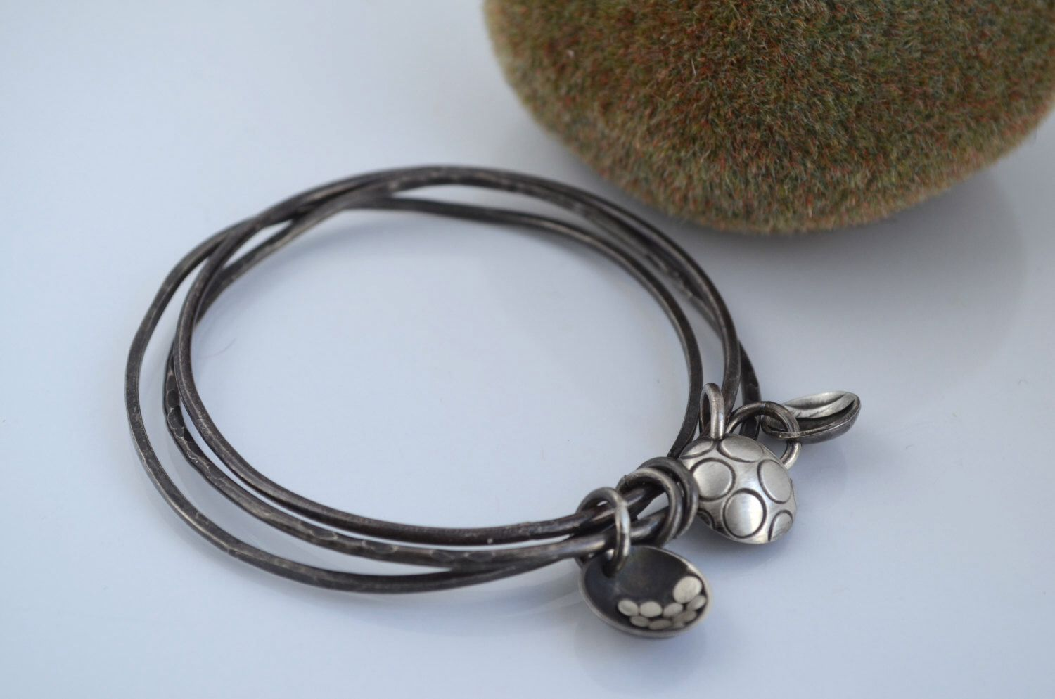 A Trio of Sterling Silver Bangles with Handmade Charms by ReaganHayhurst on Etsy https://www.etsy.com/listing/220446775/a-trio-of-sterling-silver-bangles-with