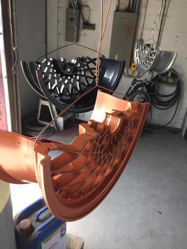 Rims mid way through the paint process| Durable Powder Coating