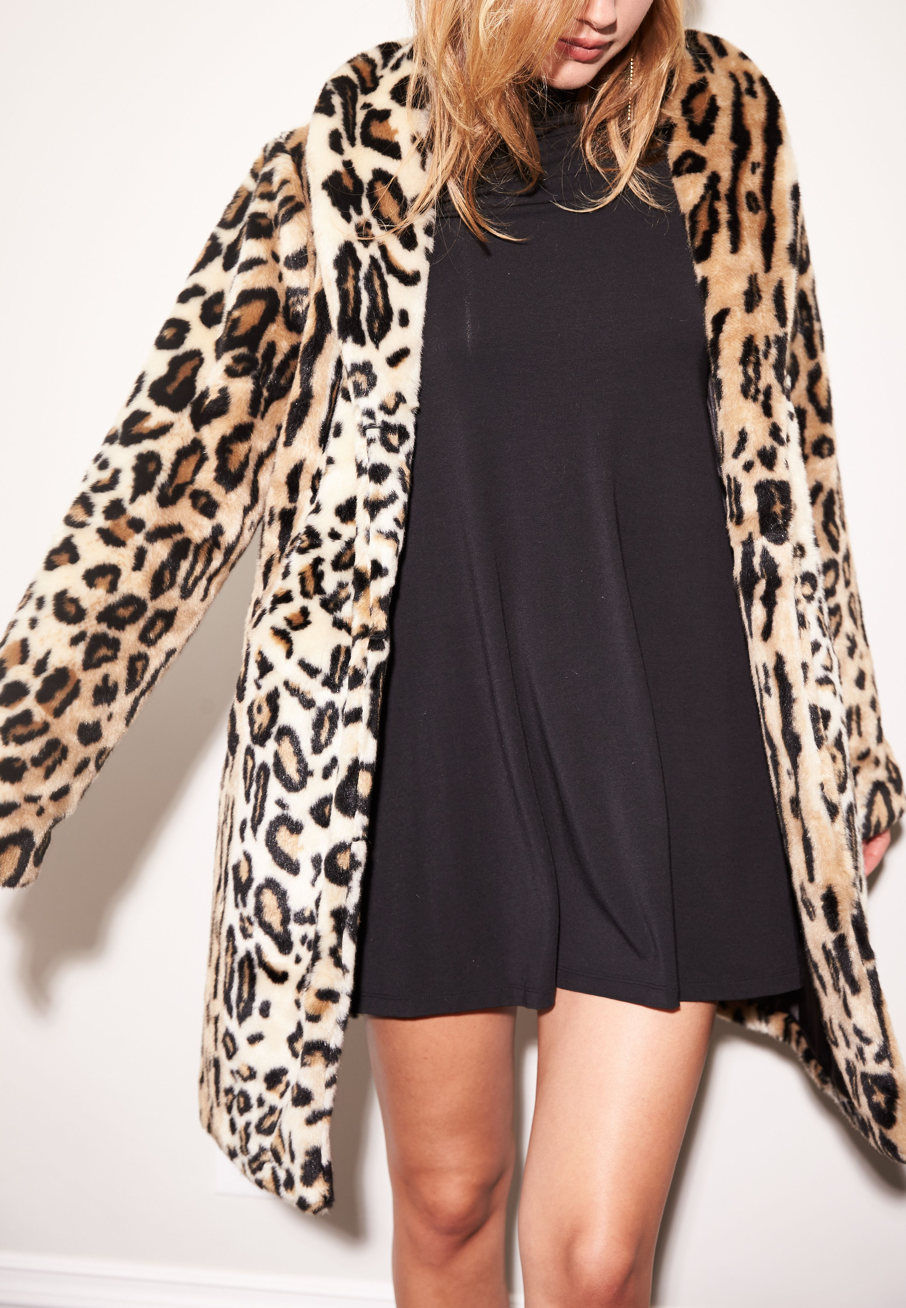 97302df07ebd Every fashionista needs her statement jacket! This luxurious faux fur  leopard print coat is a MUST this season. Model wears a size x-small. Faux  Fur.