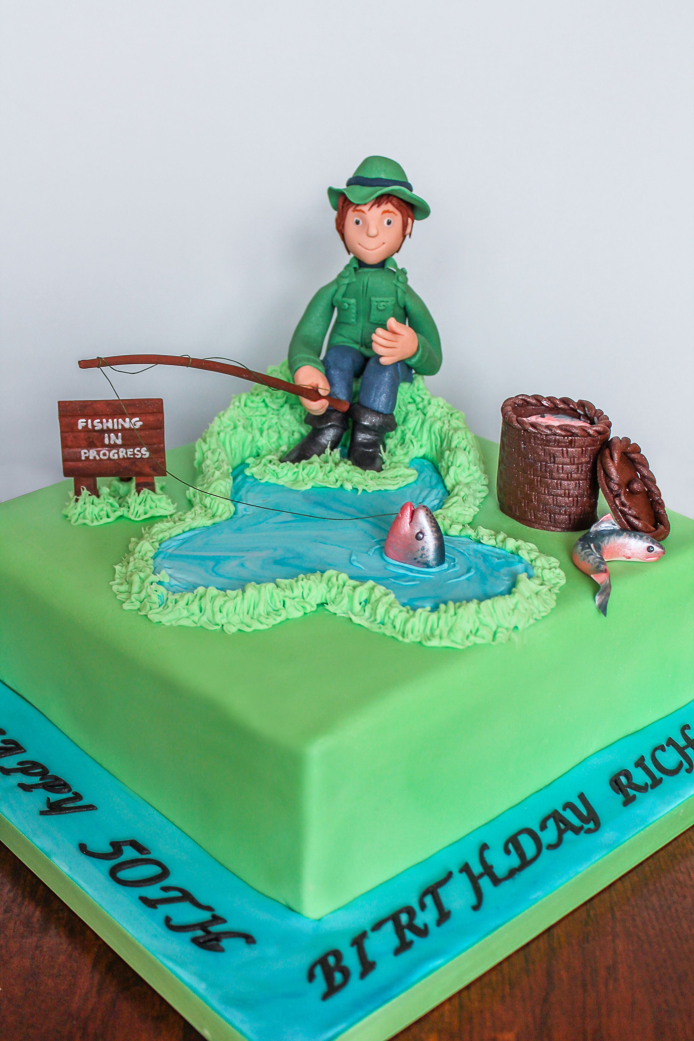 My latest unique cake designs of a man fishing for a 50th Birthday