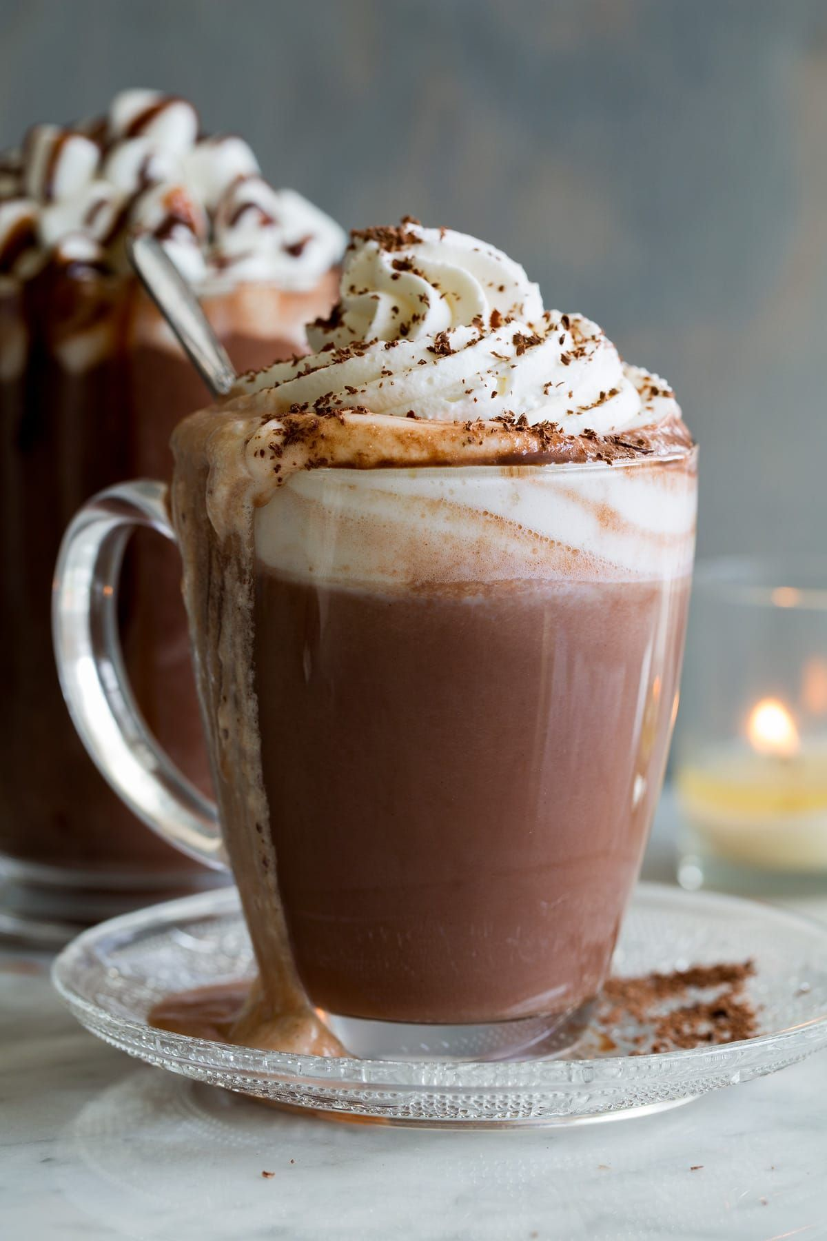Hot Chocolate shown here in a glass mug with whipped cream