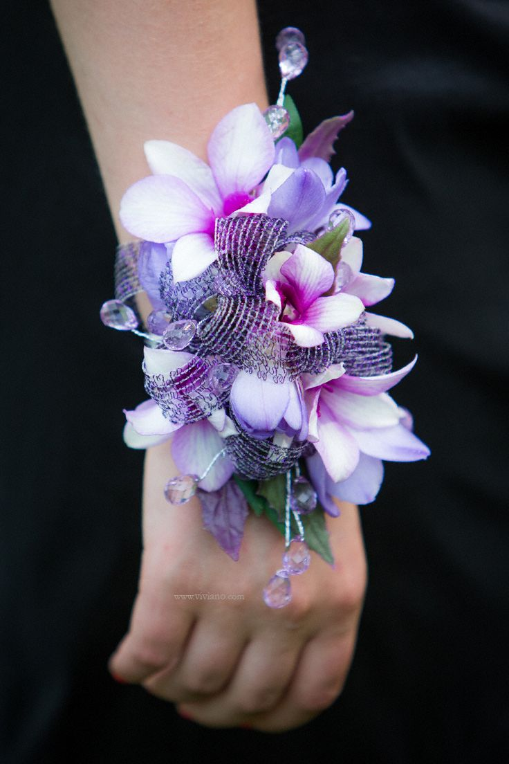 Custom purple and lavender corsage wristlet by viviano flower shop