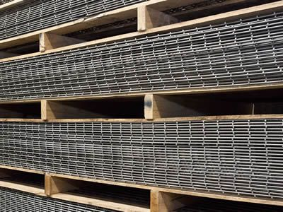 Stainless steel welded mesh panels are packaged in wooded pallets ...