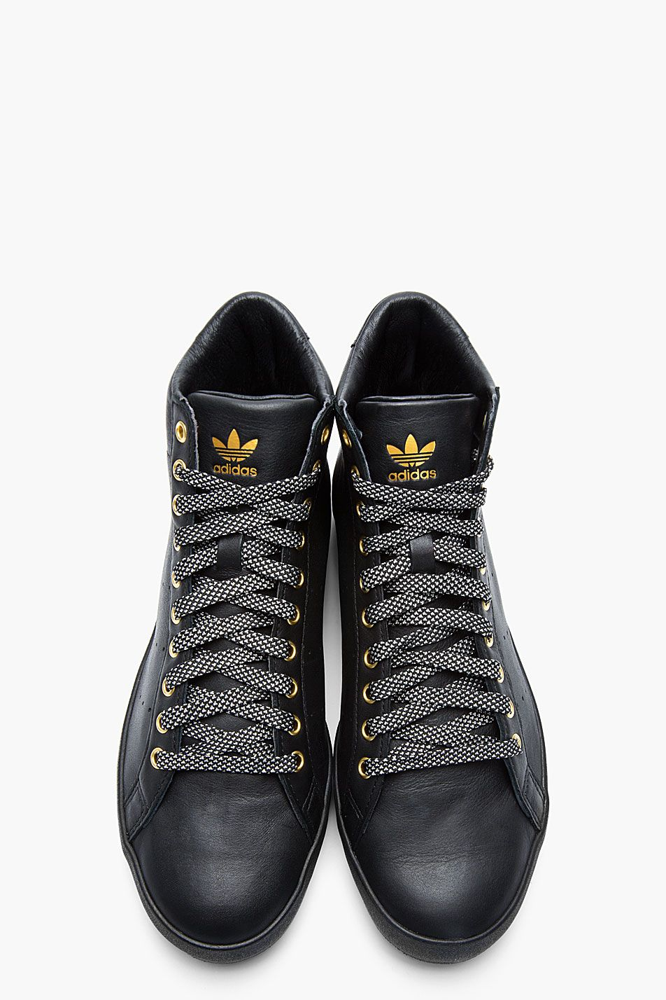 ADIDAS ORIGINALS BY O.C. Black and gold leather Rod Laver Vintage mid-tops