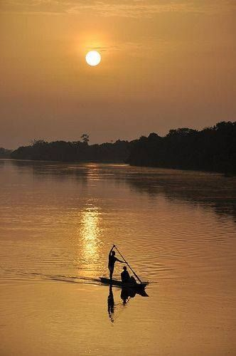 View at dusk from a Congo river barge near Kisangani, Peter Gostelow