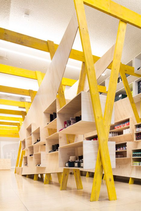 Tandem Installs Elaborate Wooden Shelving Inside Hugg Health And