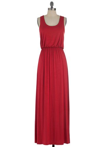 This dress is pretty too and might look good with the roses if they are in bloom!