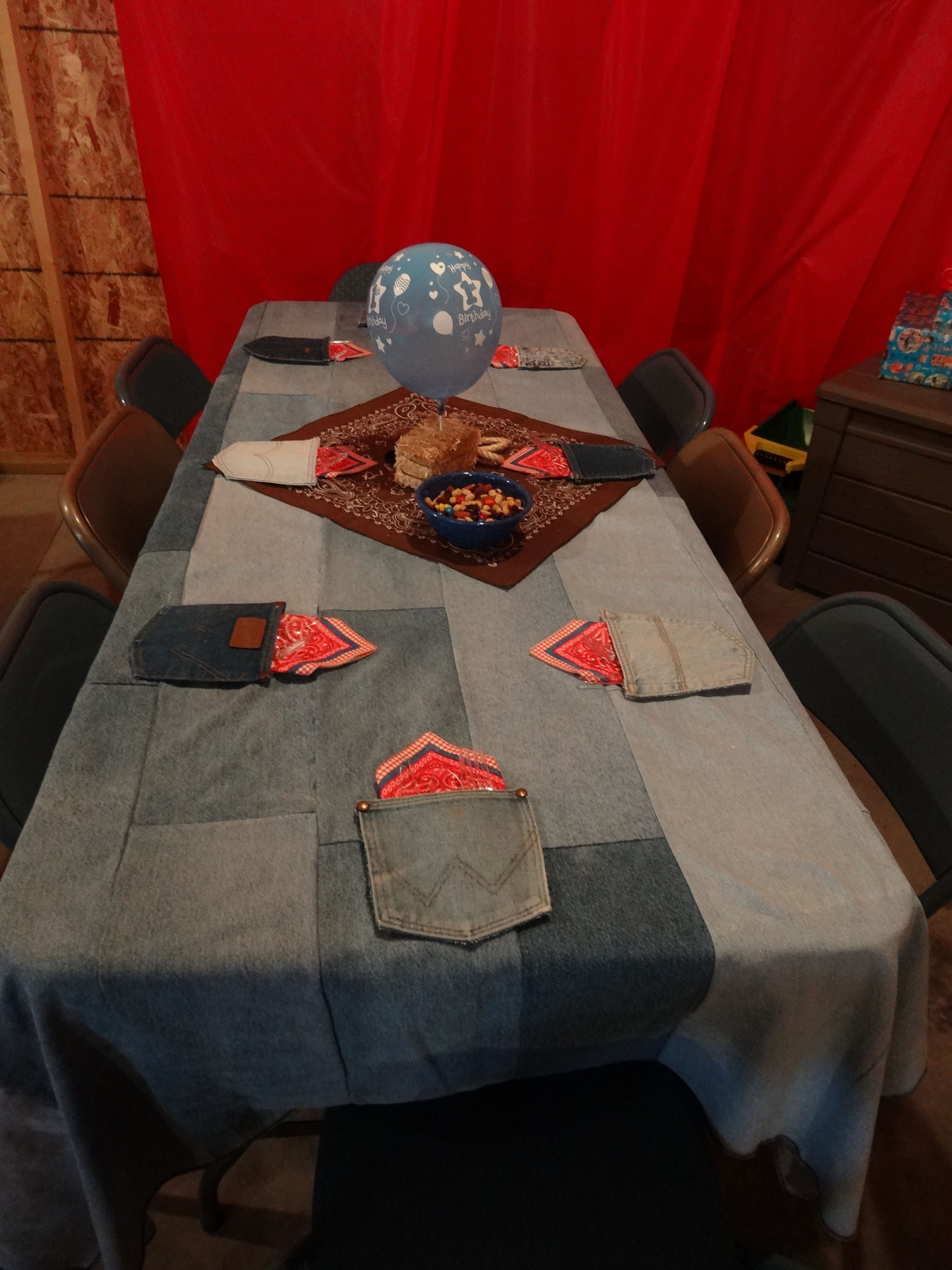 Wild West Cowboy Birthday Party Ideas...Upcycled denim used to make tablecloth & pockets cut out from jeans can be used for napkin and silverware holders.