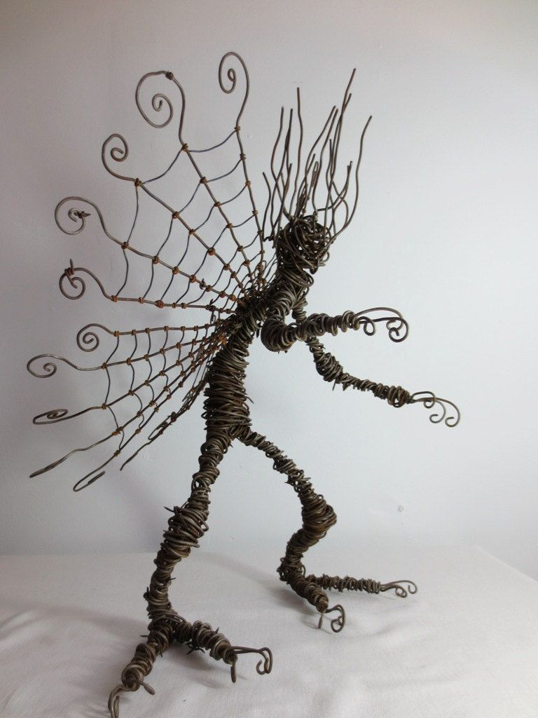 badassery. A Wee Minion Barbed Wire Creature With Spider Web Wings ...