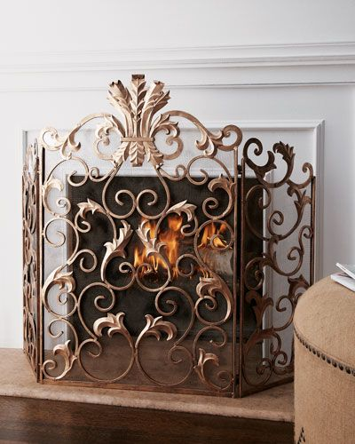 Handcrafted fireplace screen. Made of iron. Mesh backing, so it ...