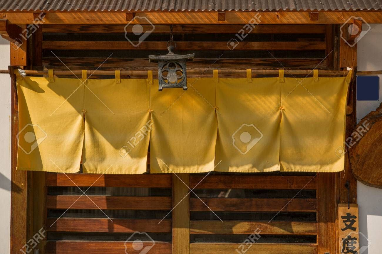 Noren curtains at the entrance to a Japanese restaurant. Editorial , #SPONSORED, #entrance, #curtains, #Noren, #Editorial, #restaurant