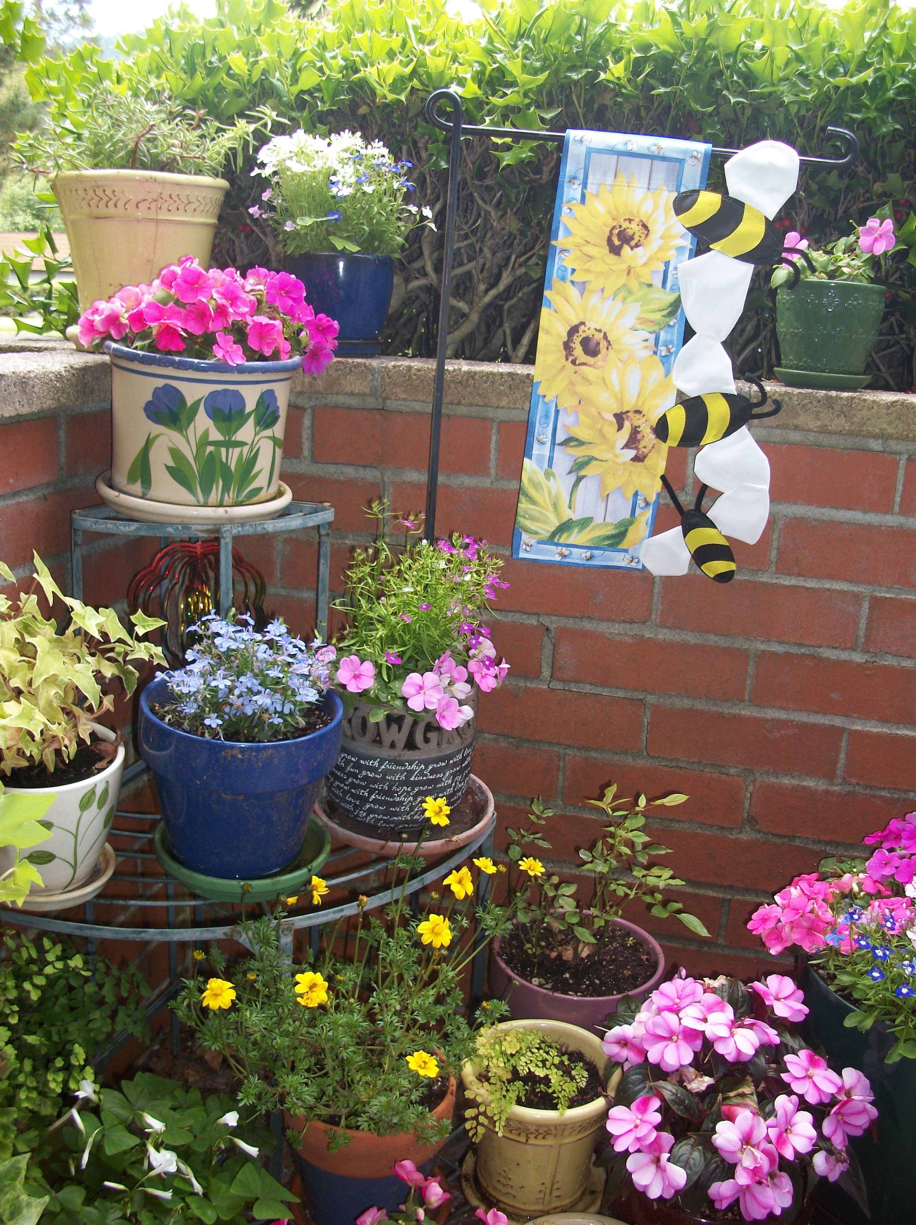 Front porch garden corner. | Front porch flowers, Front porch garden, Porch  flowers