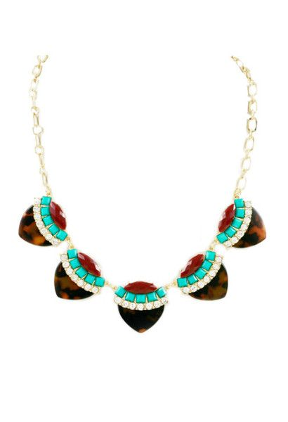 Stand out in our Tortoise Accent Necklace, adding a pop of color to the chic tortoise trend!