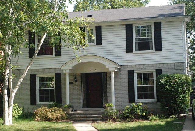 Painted Grayish Brick Black Shutters White Siding House Paint Exterior House Exterior Painted Brick House