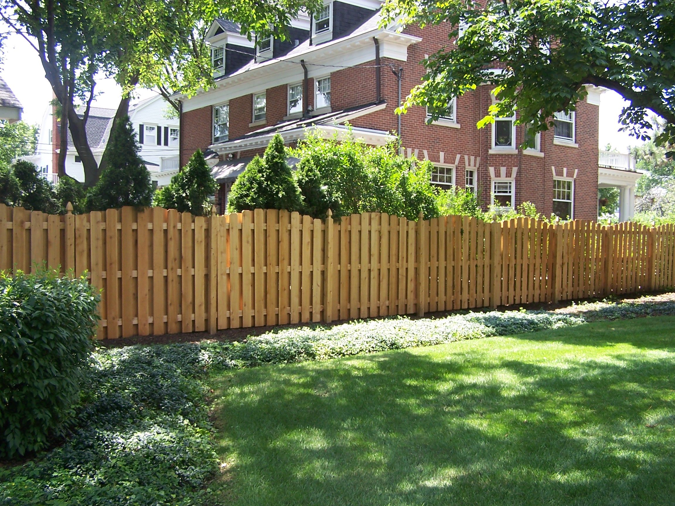 Shadow Board Fence With A Rolling Arched Pattern Rustic Fence Garden Projects Cedar Fence
