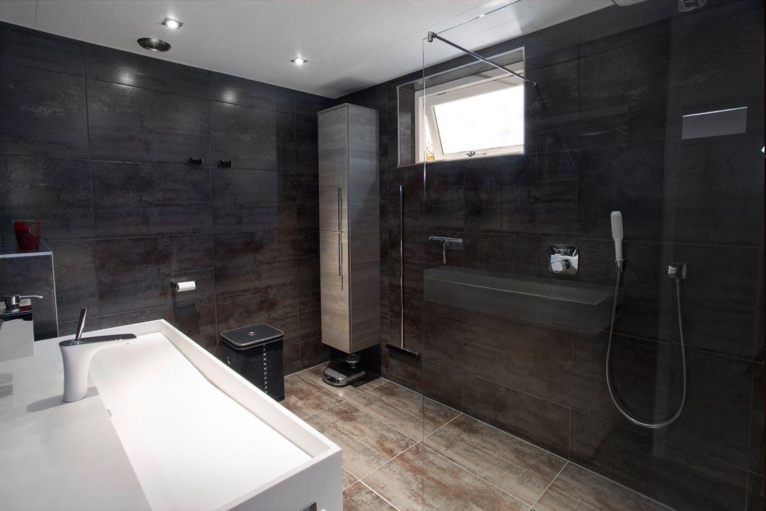 Deze badkamer staat geheel in het teken van ontspanning en rust