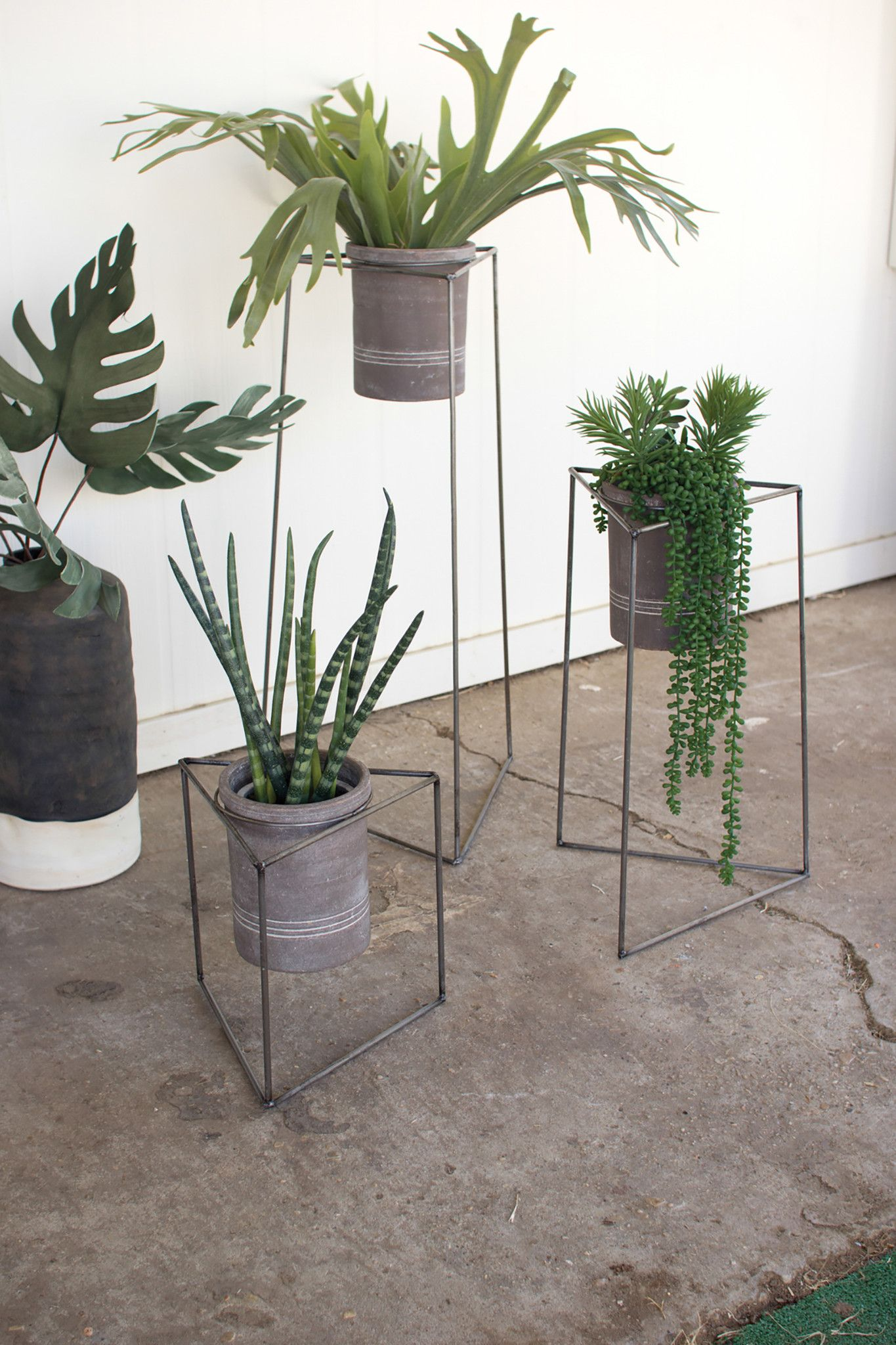 set of  industrial modern triangle planter stands with gray clay pots. set of  industrial modern triangle planter stands with gray clay