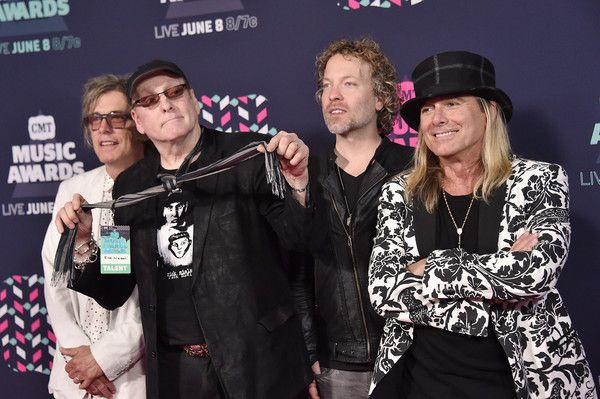 Robin Zander Photos Photos - Cheap Trick's Tom Petersson, Rick Nielsen, Daxx Nielsen, and Robin Zander attend the 2016 CMT Music awards at the Bridgestone Arena on June 8, 2016 in Nashville, Tennessee. - 2016 CMT Music Awards - Arrivals
