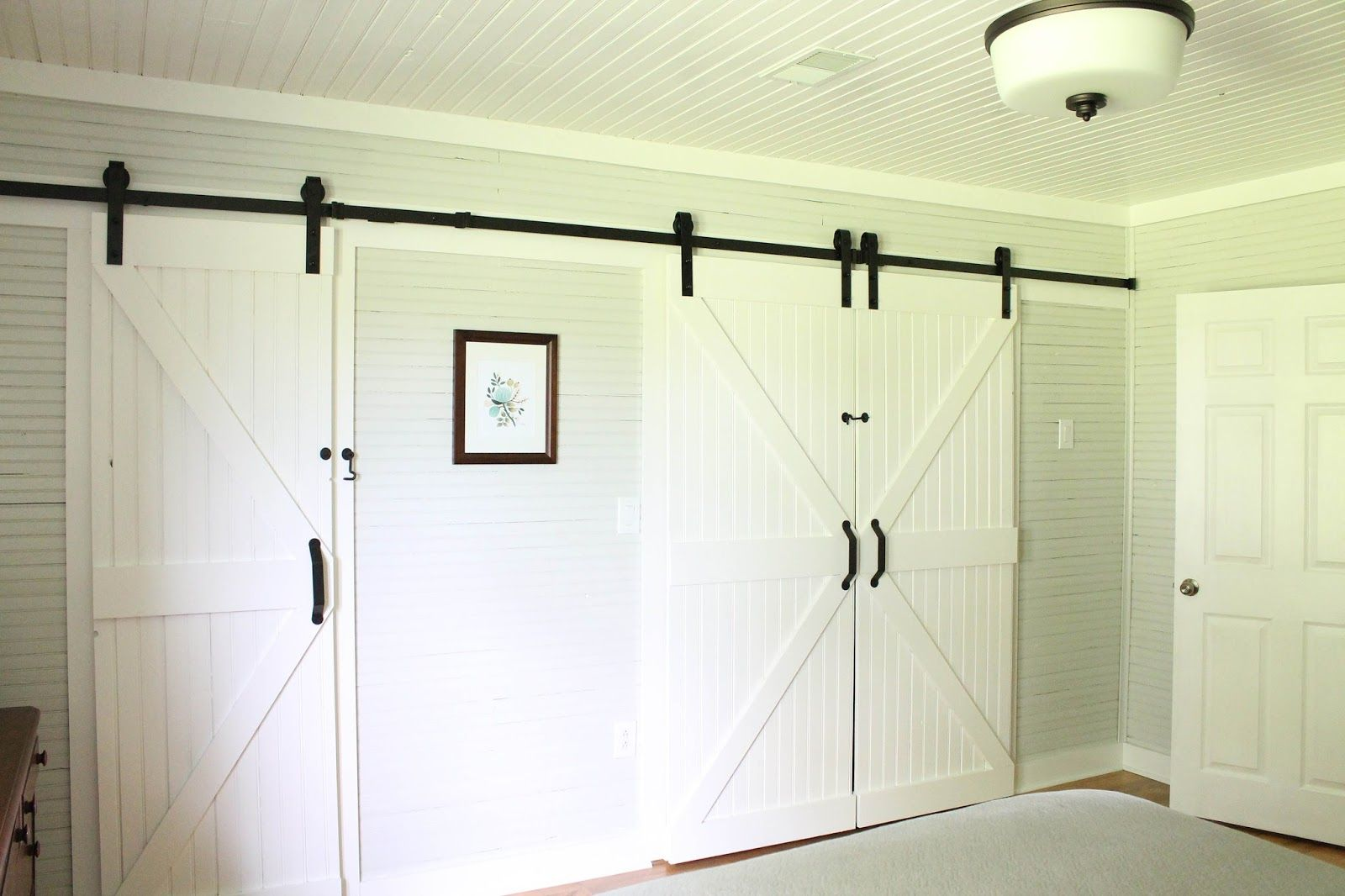 Keeping it cozy a wall of sliding barn doors to build pinterest