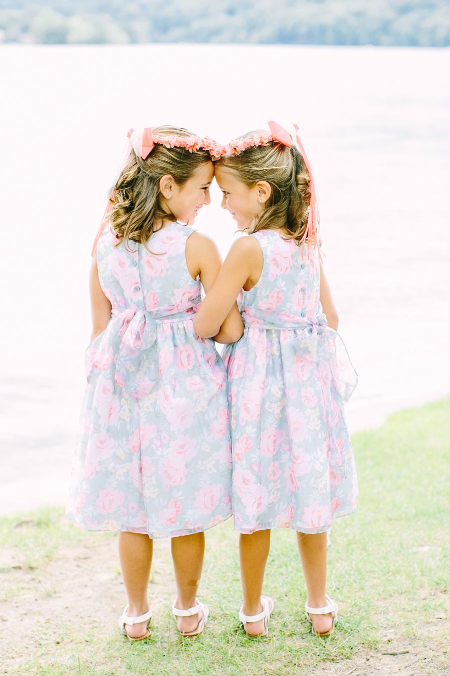The flower girls will look dreamy in these rose quartz and serenity colored dresses.