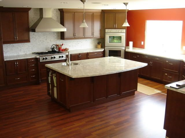 Dark Brown Cabinets White Countertops Orange Wall