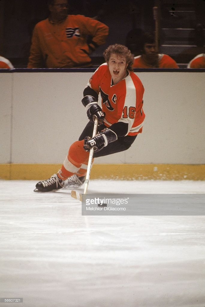 60fa8c25f8b Canadian pro hockey player Bobby Clarke of the Philadelphia Flyers moves  the puck up the ice during a road game