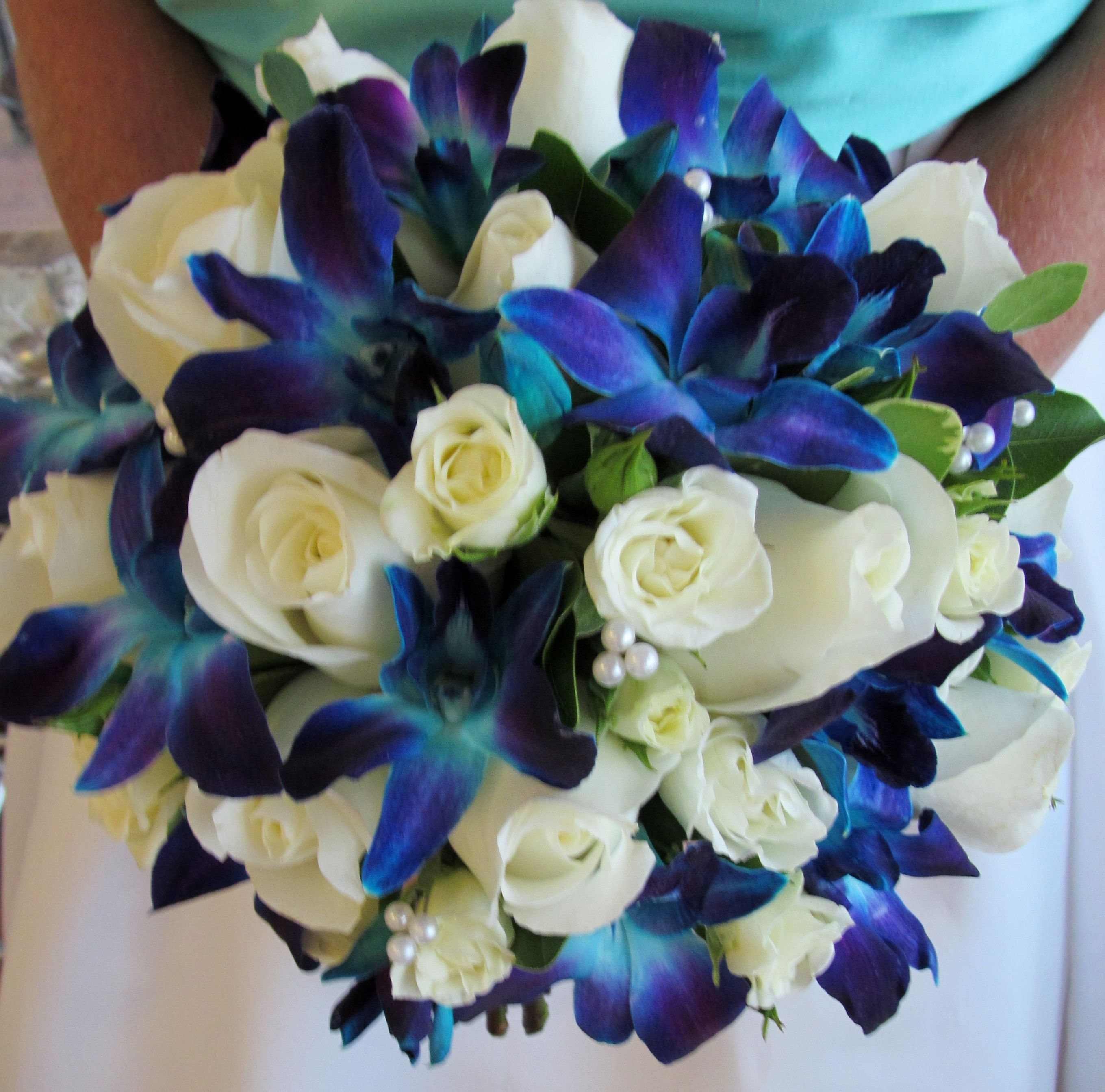 Blue Dendrobium Orchids White Roses And White Spray Roses Prom Flowers Bouquet Orchid Bridal Bouquets Wedding Flowers