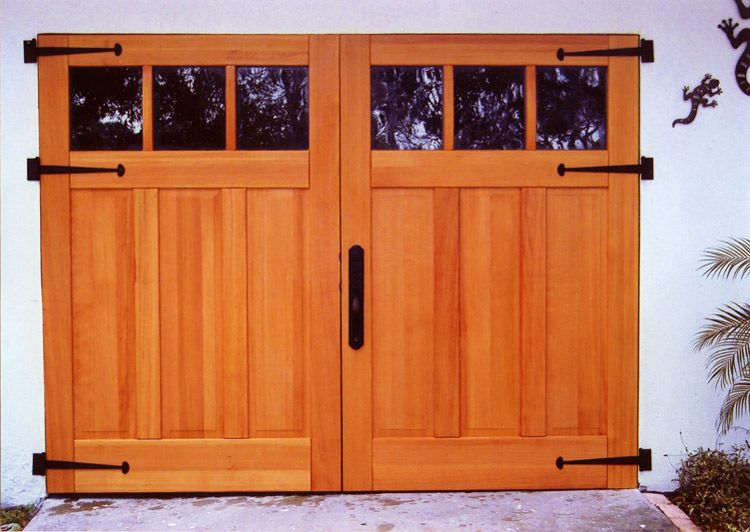 The mixture of color and natural wood with the dark glass window panels, gives a elegant look to your home. #GarageDoor #WoodenDoor