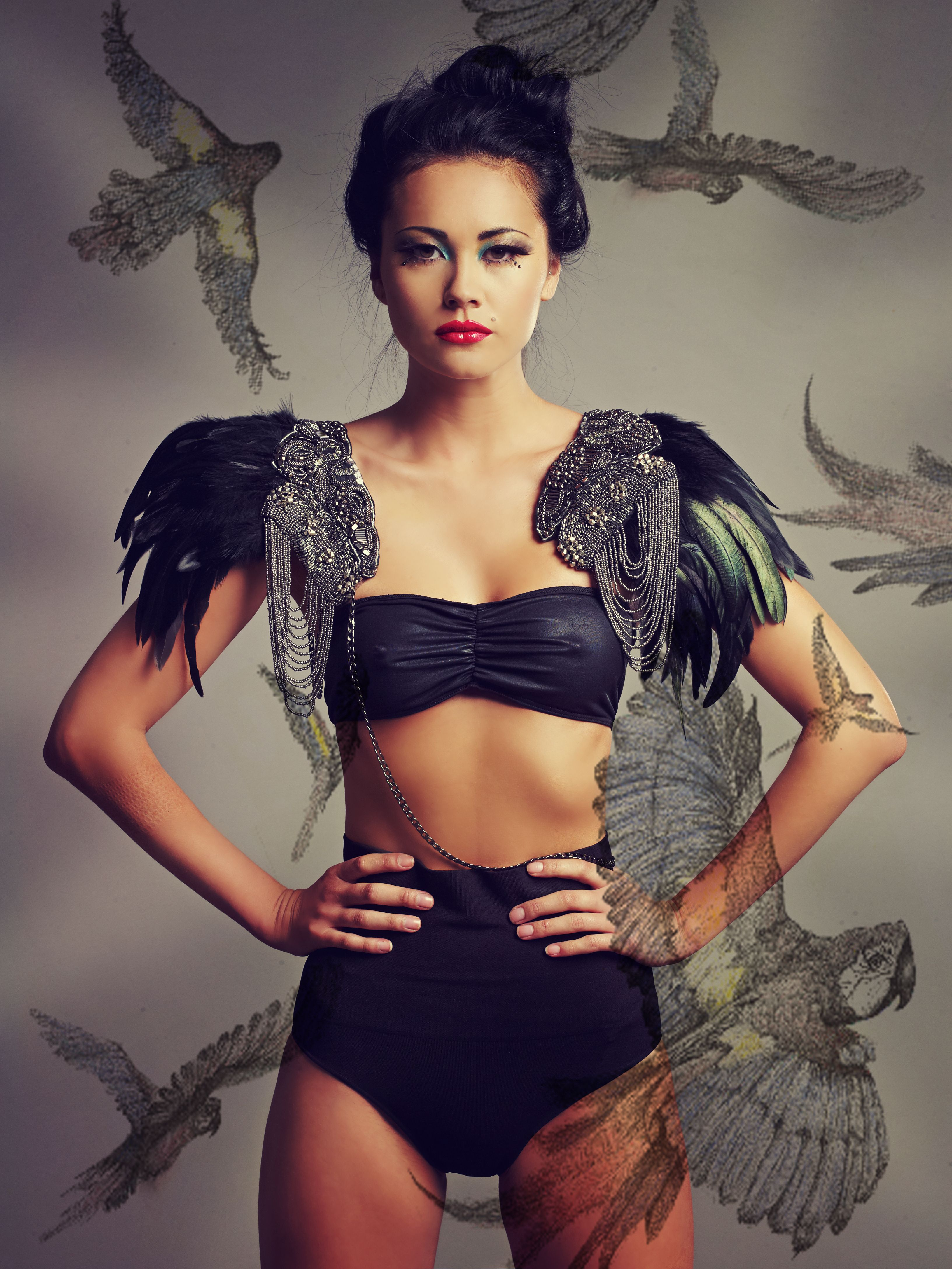 Handmade feathered shoulder piece by Boutique Alter Ego