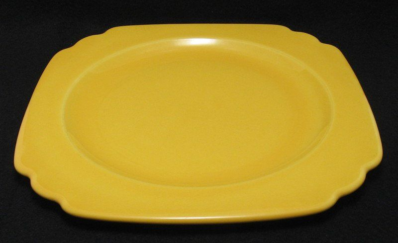 """Yellow luncheon plate from the Riviera line made by Homer Laughlin. Homer Laughlin made the Century shaped Riviera line from 1938 to 1948.  This plate measures 8 7/8"""" wide."""