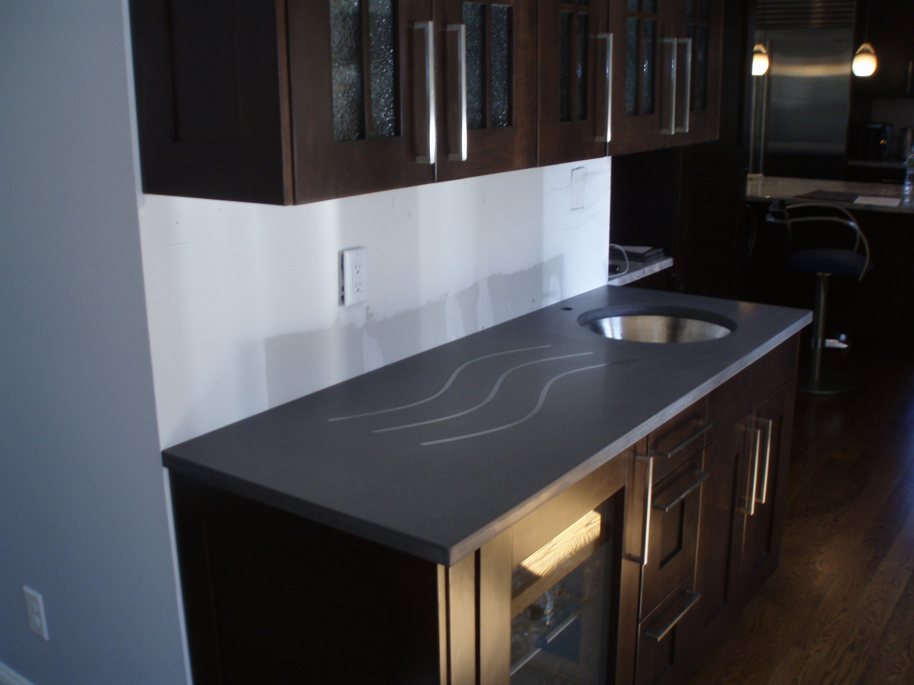 Gray concrete countertop with undermount sink cutout and integral ...