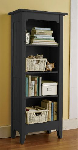 I love the style of this bookcase.  If I could find one that was a little wider and a little taller it would be perfect on the wall opposite the fireplace.