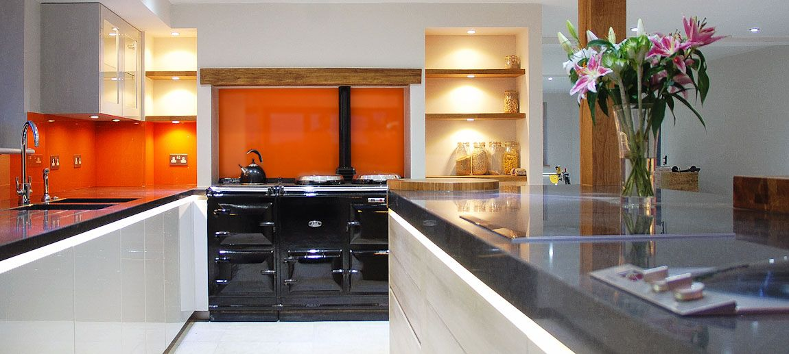 Handleless Grey Kitchen With Orange Glass Splashbacks With Images Stylish Kitchen Kitchen Design Contemporary Kitchen