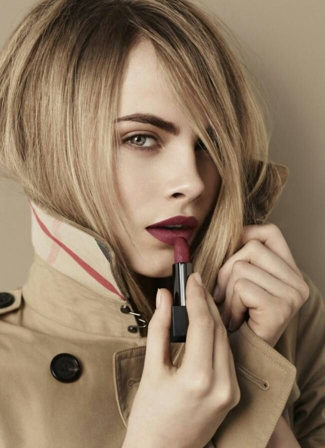 Cara Delevingne working the perfect dark red lipstick