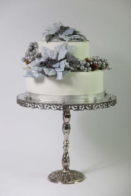White fondant christmas cake with silver gum paste pinecones