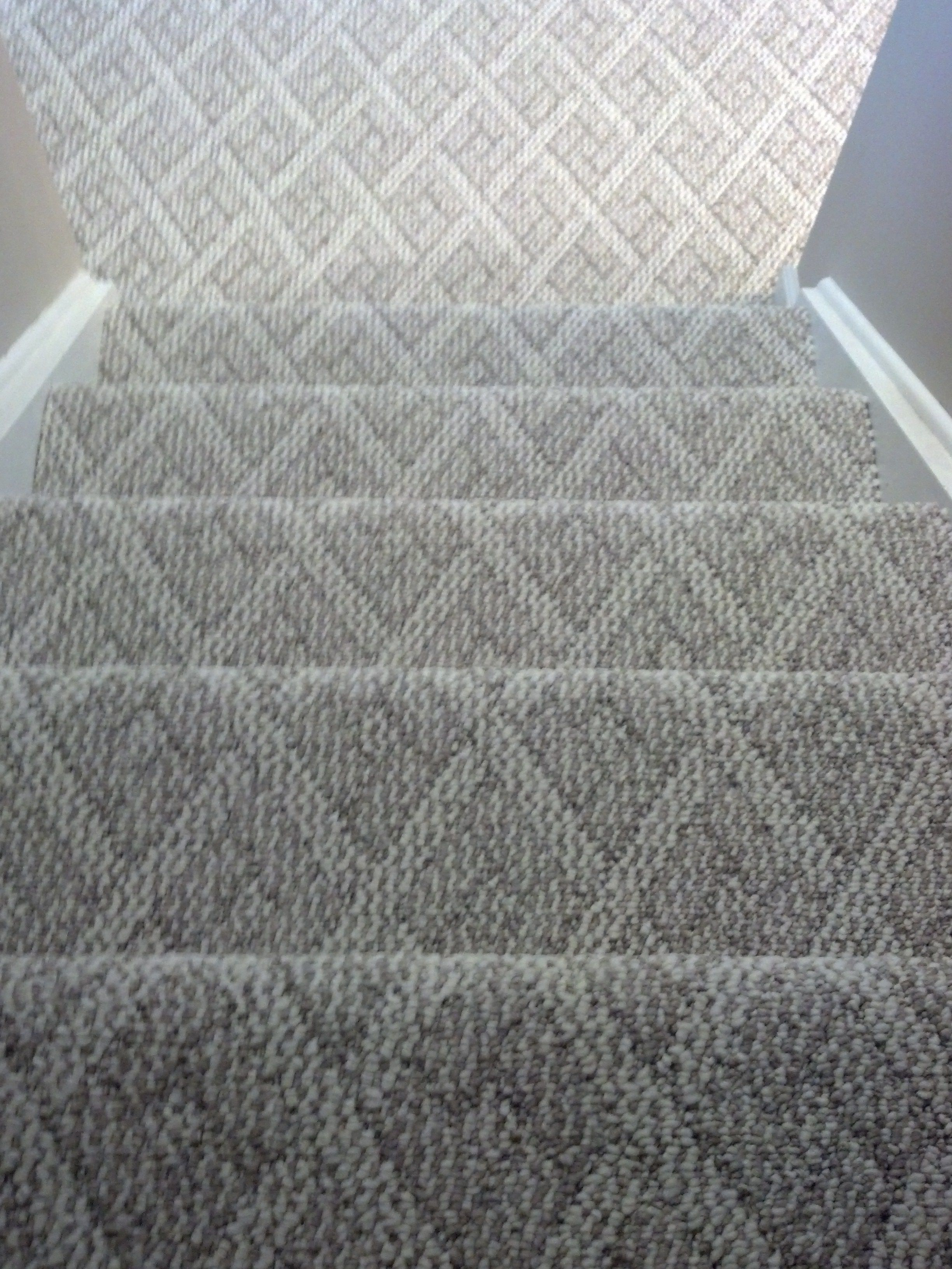 Berber carpet Cincinnati, Ohio installed on steps and basement family room. Note.....notice the pattern lining up on each step and floor.