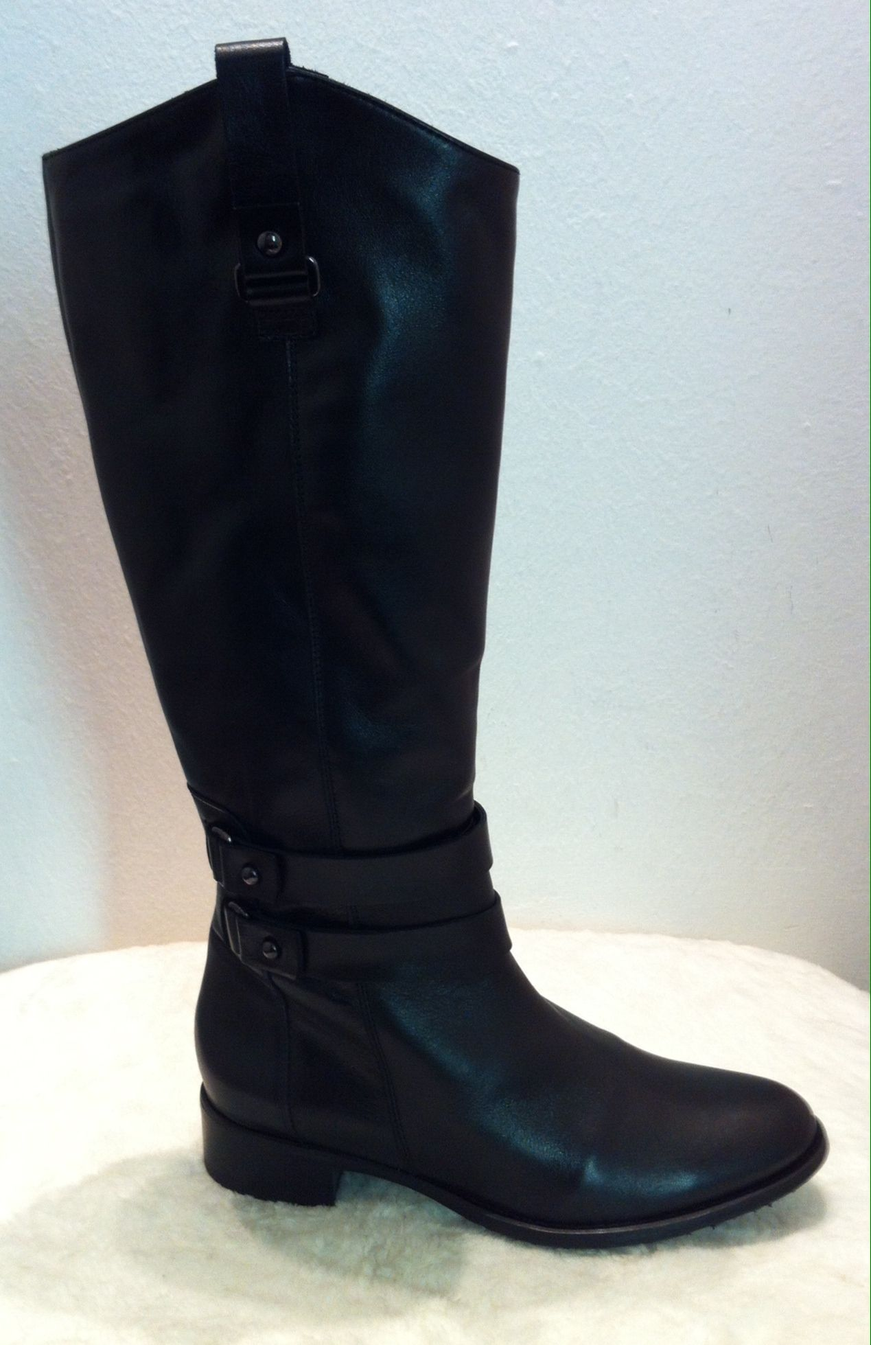 Black leather boots with clasp