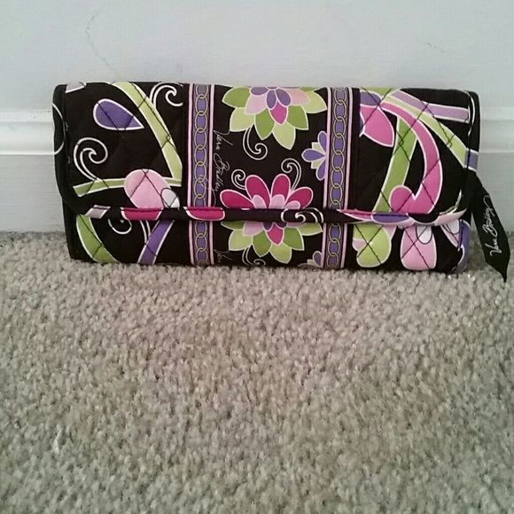 Vera Bradley wallet Has many pockets for credit cards and it has a zipper compartment for change Vera Bradley Bags Wallets