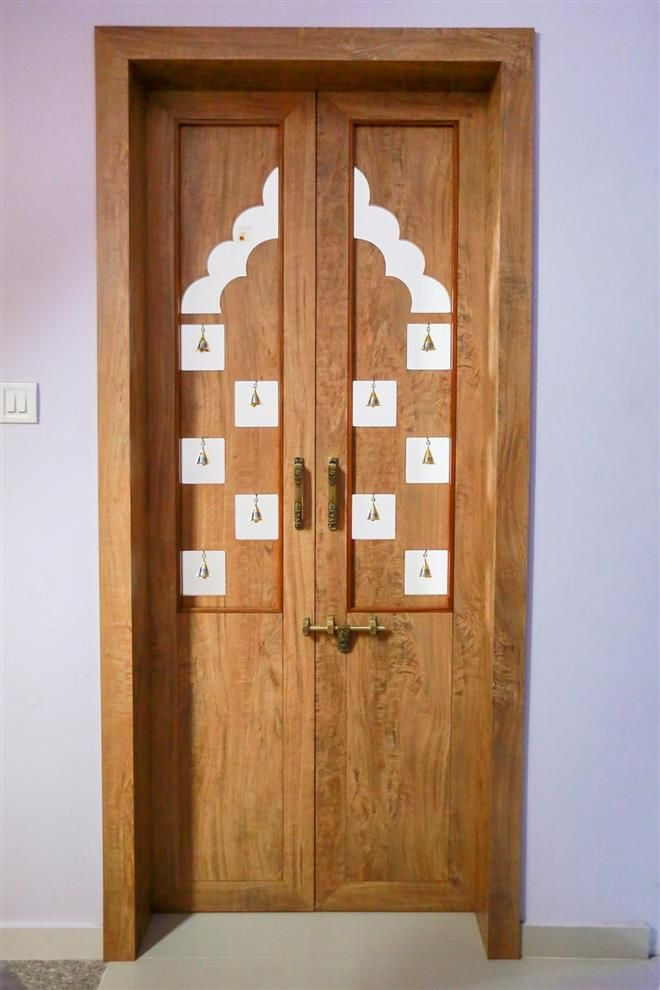 Innovative And Attractive Mandir Door Bronze Bells Is Used To Make It More Nice Pooja Room Door Design Room Door Design Door Design