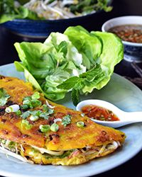 Don't be put off by the loosey-goosey nature of this crispy, egg-filled pancake. It's Viet–inspired street food at its simplest and best says Andrew Zimmern.  Slideshow: Vietnamese Recipes