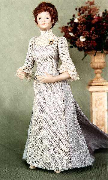 Edwardian style gown with lace covering front and sleeves.