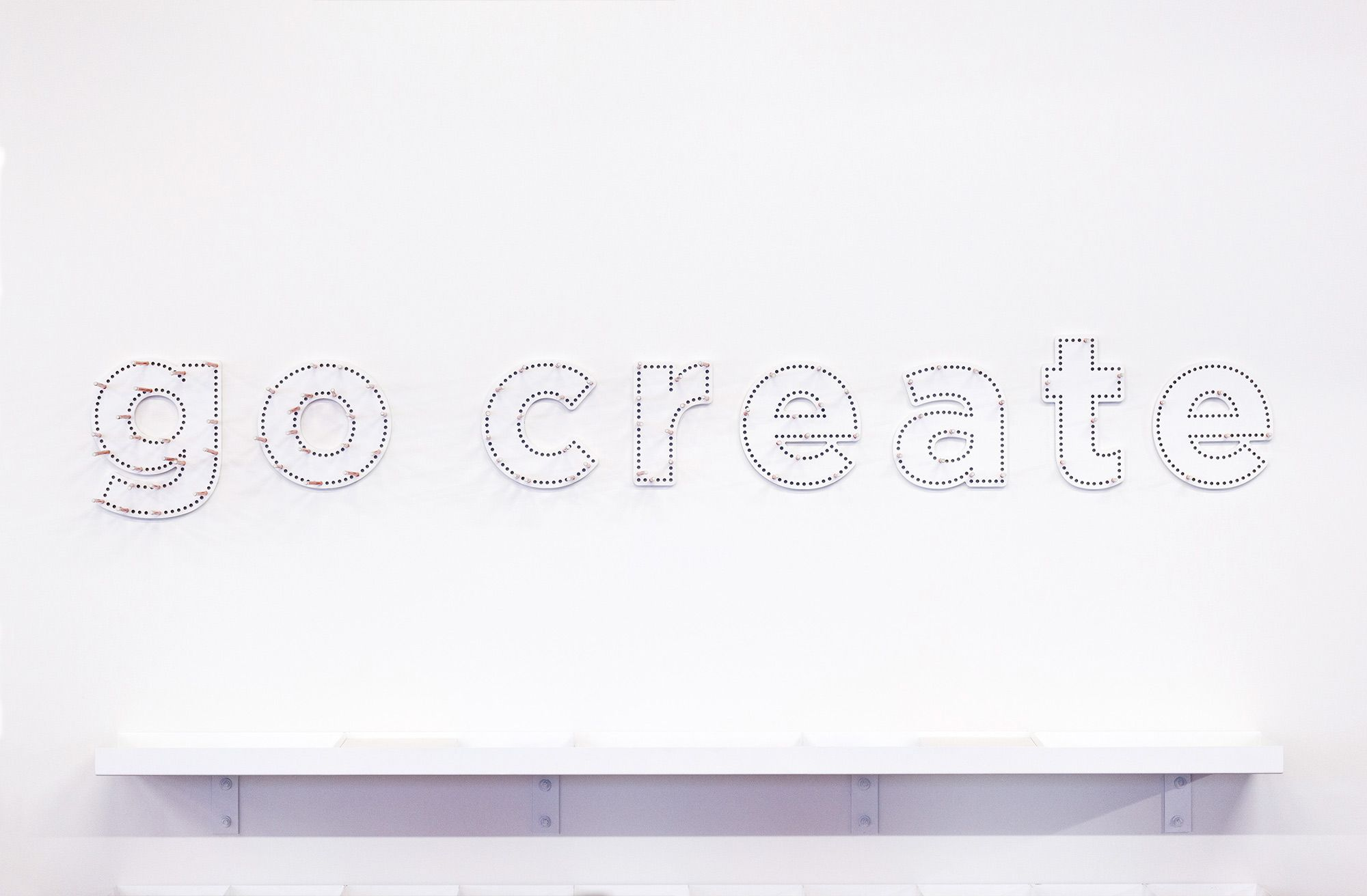 Details of wood typography for Ogilvy & Mather New Zealand HQ. @enviromeant.com