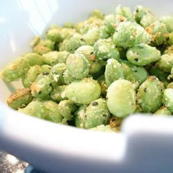 crispy edamame -1 (12 ounce) package frozen shelled edamame (green soybeans)  1 tablespoon olive oil  1/4 cup grated Parmesan cheese  salt and pepper to taste.  15 min. in a 400 oven! YAY! I love edamame!