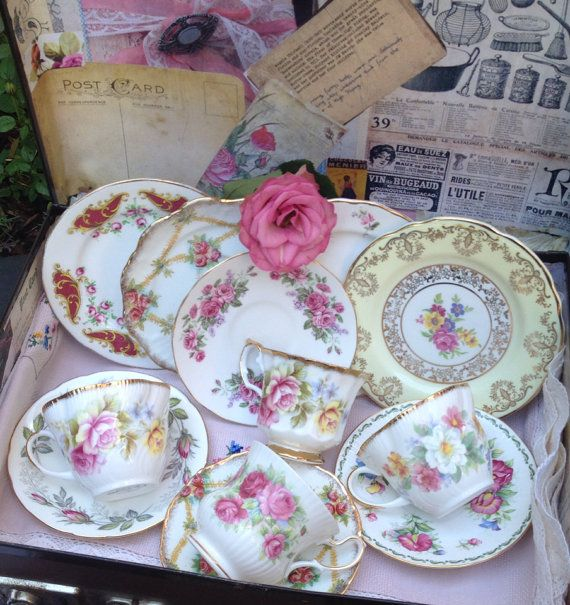 $100 Beautiful Vintage bone China mismatched tea set of four teacups, saucers and side plates with beautiful floral clusters in shades of pink, blue