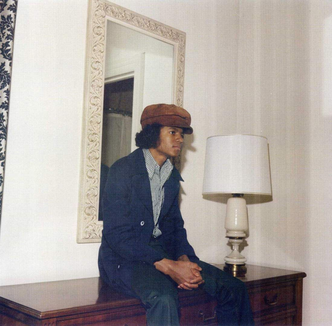 A young Michael Jackson sits in a hotel room in New York City in the 1970s.