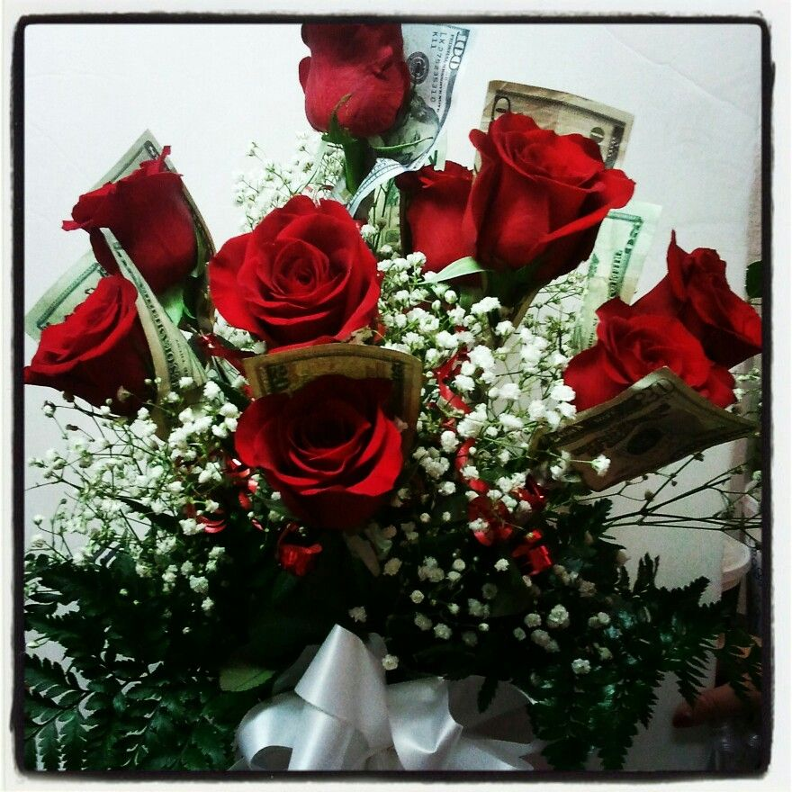 Dozen Red Roses with money wrapped on each Rose Wrapping